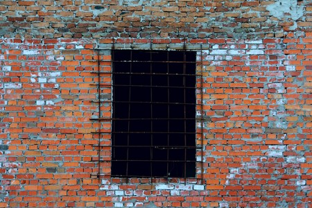 An old wall made from bricks with a window photo