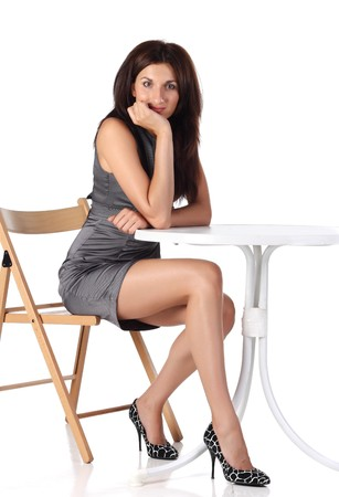 Girl sitting on a chair near the table