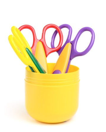 Some scissors in the container isolated on the white background