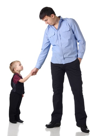 Man and little boy shaking hands isolated on the white photo