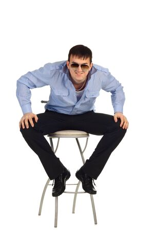 Funny guy sitting on the chair isolated on the white Stock Photo - 8784912