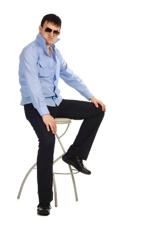 Funny guy sitting on the chair isolated on the white photo