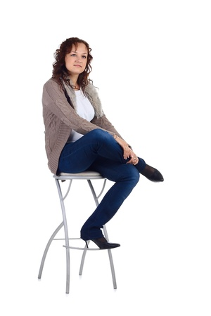 1 person: Girl sitting on the bar chair at white background