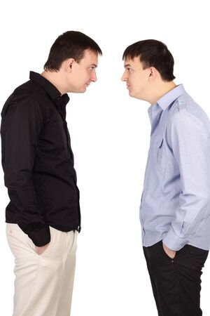 Two guys looking at each other at white background photo