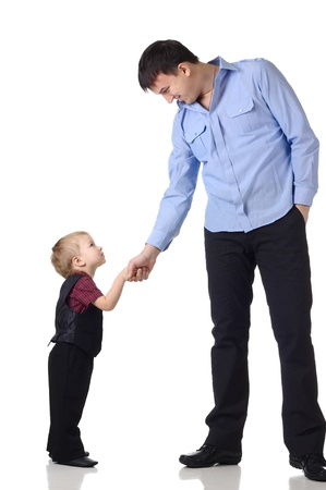 Man and little boy shake hands isolated on the white Stock Photo - 8899985