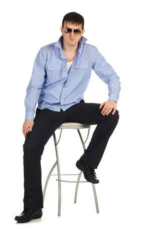 Funny guy sitting on the chair isolated on the white Stock Photo - 8899984