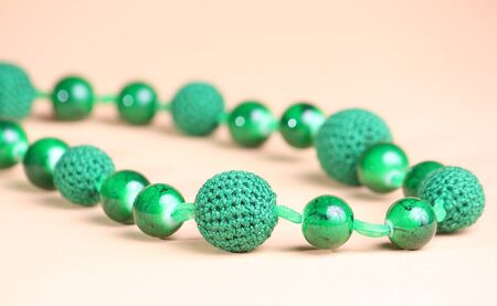 Beautiful green necklace at pink background
