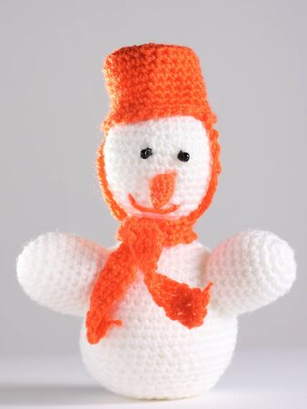 White snowman made from threads at the grey background photo