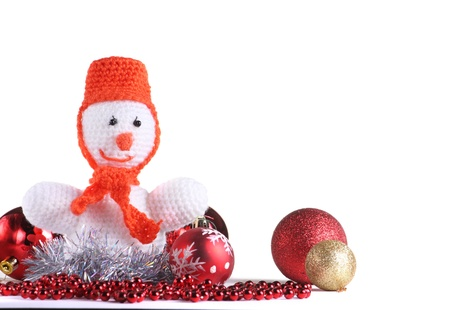 White snowman with christmas toys  made from threads at the white background photo