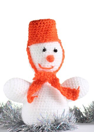 Happy snowman made from threads at the white background photo