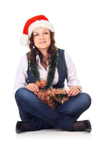 Girl in a santa hat with christmas decoration isolated at the white photo