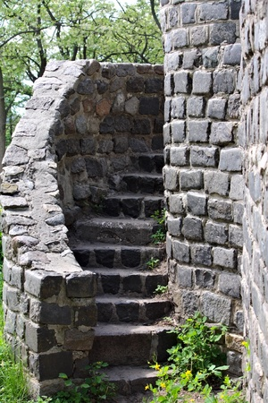 An ancient stairs of an old stone castle photo