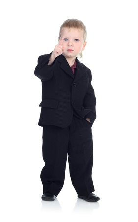 Little boy in business suit, pointing his finger isolated on the white.