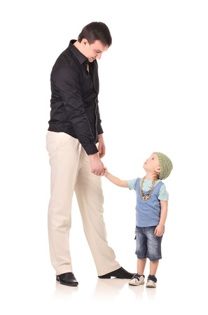tall and short: Man and little boy shaking hands isolated on the white