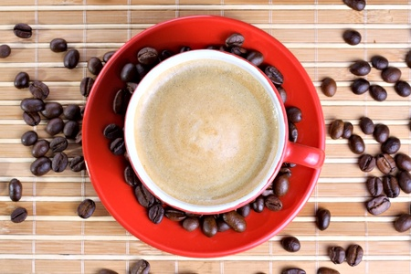 Cup of coffee with roasted beans at wooden background Stock Photo - 13028876