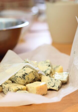 Some pieces of a blue cheese on a kitchen
