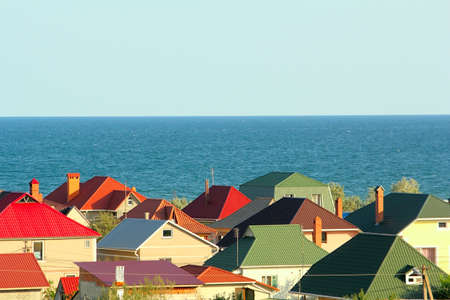 Colored roofs at the seaside with clear blue sky Stock Photo