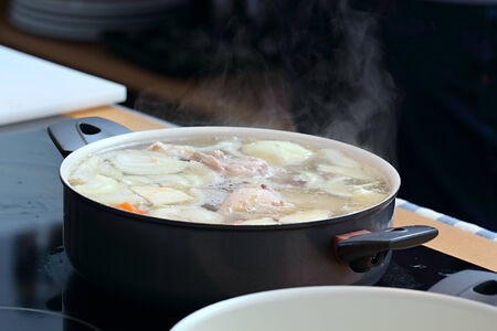 Soup in the saucepan with meat and vegetables