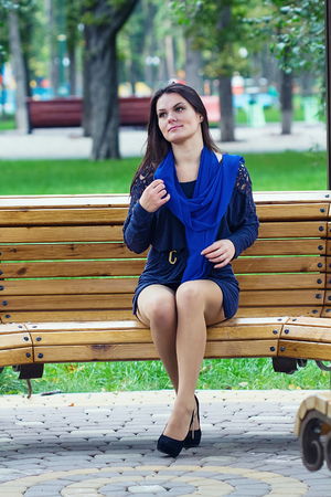 Girl sitting in the park on the bench