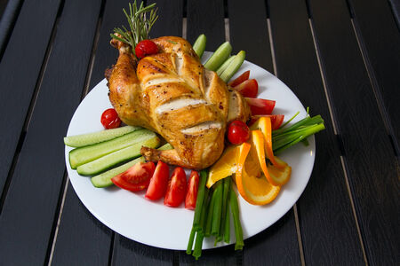 Grilled chicken on the plate with vegetables
