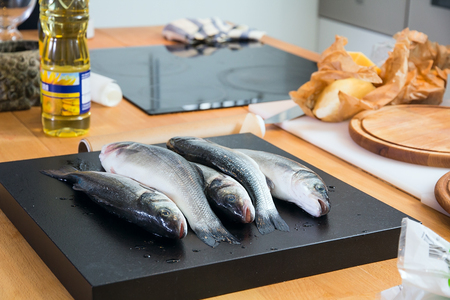 Some fishes on the kitchens table Stock Photo
