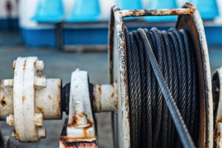 Iron wire on the winch on the deck of the ship Stock Photo - 19067390