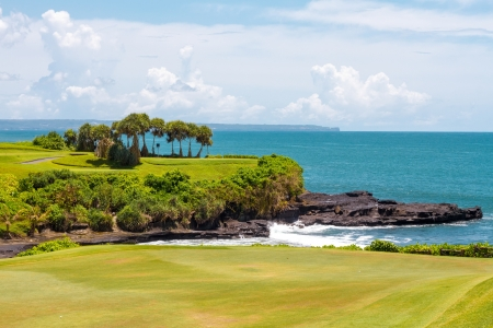 Golf course and the blue ocean in the background Stock Photo