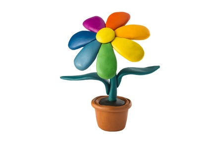 Plasticine colorful flower in a brown pot photo