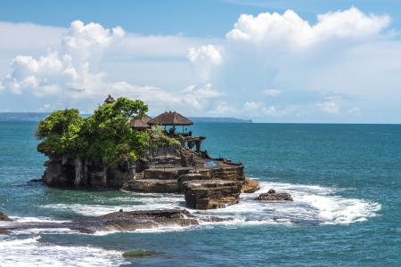 Tanah Lot temple in the ocean on a clear day photo