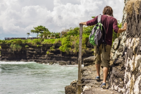 A man walking along a narrow path to the edge of a cliff Stock Photo - 19067418
