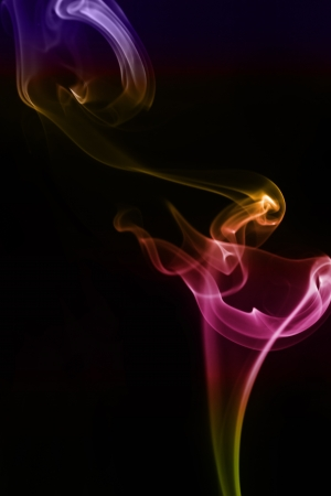 Swirling smoke from the incense on a background photo