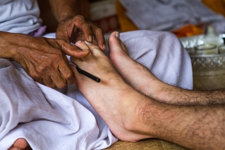 Balinese healer's hands to massage your man's legs Stock Photo - 19118208