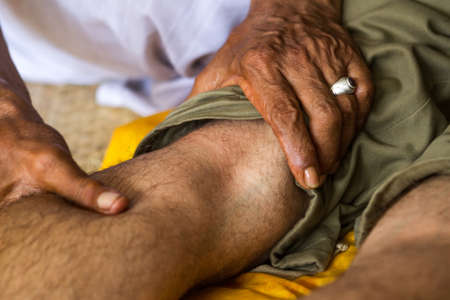 Balinese healer's hands to massage your man's legs Stock Photo - 19118227