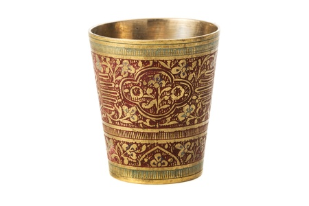 Bronze yellow cup with ornament on a white background photo