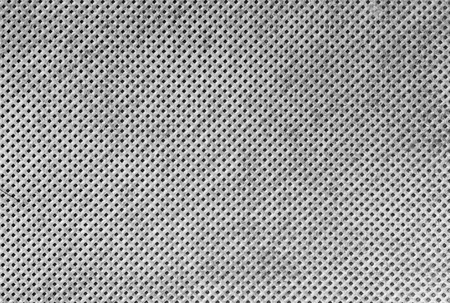 Texture of white cloth with holes in staggered rows photo
