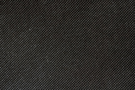 High resolution texture of cloth with holes in staggered rows photo