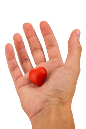 handbreadth: Heart made of plasticine in a hand on a white background