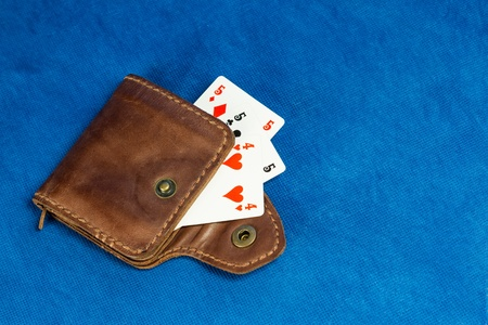 Purse made of leather and playing cards in high resolution photo