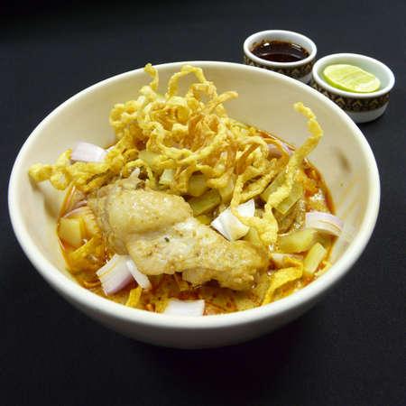 soi: thai food - khao soi kai - northern-style chicken curried noodles soup Stock Photo