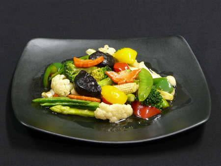 mit: healthy thai food - phad phak ruam mit - stir fried vegetables