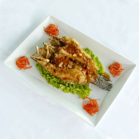 chinese seafood - deep fried sand goby fish with xo sauce in white dish - healthy food