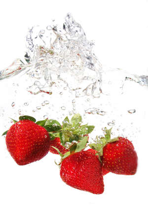 water drops and strawberries in water photo