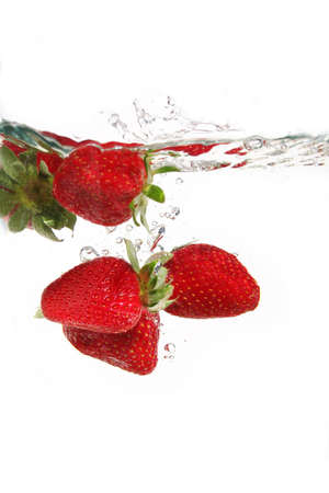 water drops and strawberries in water