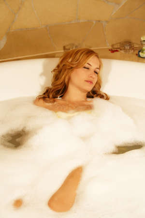 A young beautiful woman is taking a bath Stock Photo