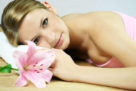 a young beautiful woman is relaxing in spa - wellness Stock Photo - 1796182