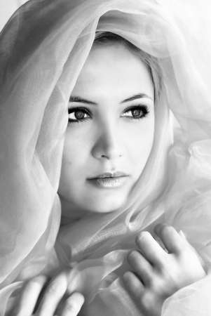 beauty portrait of a young beautiful woman with a shawl Stock Photo