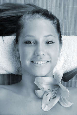 a young beautiful woman is relaxing in spa - wellness with a flower lily Stock Photo - 1848703