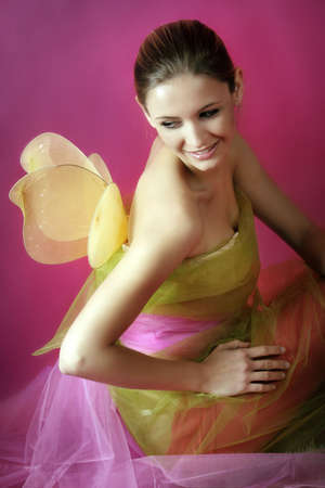 fashion and beauty portrait of a young woman with wings photo