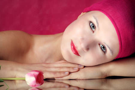 beauty portrait of a young woman in pink with a tulip flower on a mirror Stock Photo - 5003076