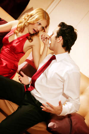 young and rich couple is sitting on a lounge and have an argue Stock Photo - 5002686